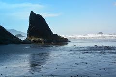 The rocky shoreline of Hug Point, Oregon. This is an outcropping of rock just south of Hug Point on the coast of Oregon Royalty Free Stock Photos