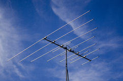 Outdated analogue tv antenna. Against blue sky Stock Photography