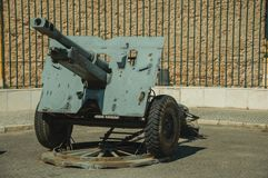 Outdated artillery piece at the Military Museum of Elvas. Elvas, Portugal - July 07, 2018. Outdated artillery piece in front of iron fence at the Military Museum royalty free stock photography