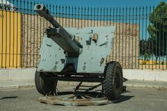 Outdated artillery piece at the Military Museum of Elvas. Elvas, Portugal - July 07, 2018. Outdated artillery piece in front of iron fence at the Military Museum stock photography