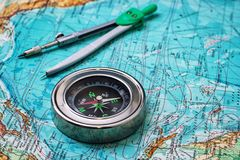Outdated compass sailor on topographic map Royalty Free Stock Images