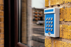 Outdated intercom device at apartment building entrance. Selective focus royalty free stock images