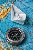 Outdated marine compass on a topographic map Royalty Free Stock Photo