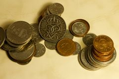 Old/outdated, and soon to be, Swedish coins in closeup stock photos