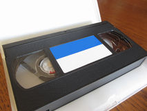 Outdated videocassette . Old video tape on wooden table Royalty Free Stock Images