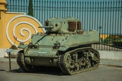 Outdated war tank at the Military Museum of Elvas. Elvas, Portugal - July 07, 2018. Outdated war tank on a sunny day in front of iron fence at the Military stock photos