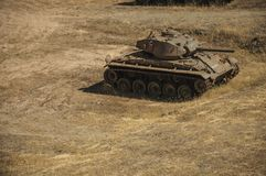 Outdated war tank in the moat next to the wall of Elvas. Elvas, Portugal - July 07, 2018. Outdated war tank next to the wall that encircle the city of Elvas. A royalty free stock image
