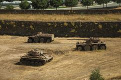 Outdated war tanks in the moat next to the wall of Elvas. Elvas, Portugal - July 07, 2018. Outdated war tanks next to the wall that encircle the city of Elvas. A stock photos