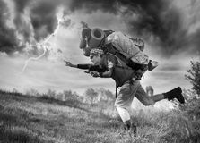 Huge novice backpack in the mountains. An outdated way of traveling is a huge uncomfortable backpack stuffed with cumbersome heavy equipment. Ancient camera- as Stock Photography