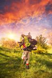 Huge novice backpack in the mountains. An outdated way of traveling is a huge uncomfortable backpack stuffed with cumbersome heavy equipment. Ancient camera- as Royalty Free Stock Photo