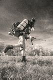 Huge novice backpack in the mountains. An outdated way of traveling is a huge uncomfortable backpack stuffed with cumbersome heavy equipment. Now things in the Royalty Free Stock Photo
