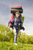 Huge novice backpack in the mountains. An outdated way of traveling is a huge uncomfortable backpack stuffed with cumbersome heavy equipment. Now things in the Royalty Free Stock Image