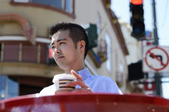 Outddoors young man with hot drink Stock Images