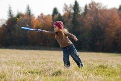 Outdoor activity. Little girl playing kid's tennis on the lawn Stock Photography