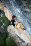 Outdoor activity. Extreme rock climbing lifestyle. Male rock climber on a cliff wall. Siurana, Spain. Sport Stock Photos