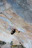 Outdoor activity. Extreme rock climbing lifestyle. Male rock climber on a cliff wall. Siurana, Spain. Stock Images