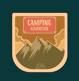 Outdoor adventure badge and retro emblem, created in orange colo Royalty Free Stock Photography