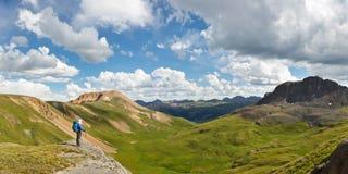 Outdoor Adventure Panorama. Hiker enjoys grand view of alpine tundra in Colorado, USA Stock Photo