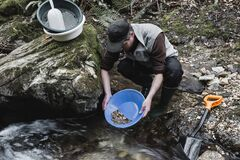 Outdoor adventures on river. Gold panning