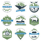 Outdoor Adventures And Tourism Colorful Logos. With mountains peaks and rocks isolated vector illustration Royalty Free Stock Photos