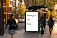 Outdoor advertising. Bus shelter with foot traffic Stock Photography