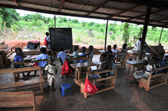 Outdoor African Elementary School Classroom. Students attending class in an outdoors elementary school classroom in the Yilo Krobo District not far from Accra Stock Photo