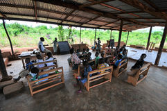 Outdoor African Elementary School Classroom. ASIAFO AMANFRO, EASTERN, GHANA - NOVEMBER 14: Students attending class in an outdoors elementary school classroom in Royalty Free Stock Images