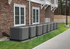 Outdoor air conditioning and heat pump units. Outdoor heat pump as used in houses without central heating or air conditioning that produces cold or hot air stock image
