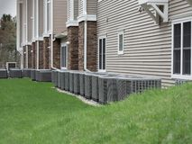 Outdoor air conditioning and heat pump units. Outdoor heat pumps as used in houses without central heating or air conditioning that produces cold or hot air royalty free stock images