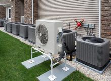 Outdoor air conditioning and heat pump units. Outdoor heat pumps as used in houses without central heating or air conditioning that produces cold or hot air stock photo