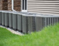 Outdoor air conditioning and heat pump units. Outdoor heat pumps as used in houses without central heating or air conditioning that produces cold or hot air stock photography