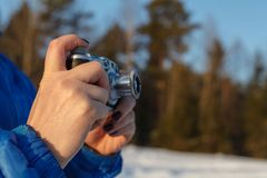 Outdoor amateur photography concept, vintage camera in hands royalty free stock photos