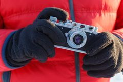 Outdoor amateur photography concept, vintage camera in hands stock images