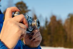 Outdoor amateur photography concept, vintage camera in hands stock photography
