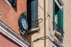 Outdoor analog wall street clock in Venice, Italy Stock Image