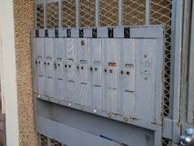 Outdoor apartment mailboxes with rusty look and dirty state units 1 to 8 royalty free stock photos