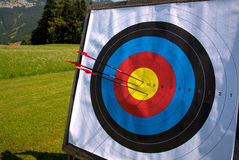 Outdoor archery target hit by 3 arrows Stock Photo