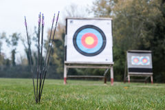 Outdoor archery targets on grass field surrounded by forest. Stock Photo