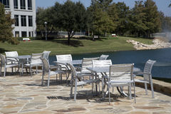 Outdoor architecture and group of tables and chairs Stock Images