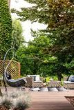 Summer retreat on sunny day. Outdoor area of a summer retreat with cozy garden furniture on a sunny day stock image