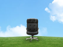 Outdoor armchair on green land. Good concept for free position, career, out of box and peace of mind Stock Image