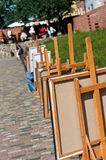 Outdoor art display. Abstract with canvas easels lined up royalty free stock images