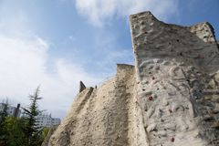 Outdoor artificial climbing wall Royalty Free Stock Image