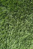 Outdoor artificial green grass turf textured background Royalty Free Stock Photos