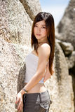 Outdoor asian girl in casual clothes. Asian girl in casual wear with a beautiful long hair Royalty Free Stock Images