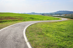 Outdoor asphalt road, exercise bike paths on the hill Royalty Free Stock Photography