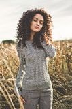 Atmospheric portrait of beautiful young lady. Outdoor atmospheric lifestyle photo of young beautiful lady. Brown hair and eyes. Warm fall. Autumn vibes. Softness Royalty Free Stock Image