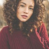 Atmospheric portrait of beautiful young lady. Outdoor atmospheric lifestyle photo of young beautiful lady. Brown hair and eyes. Warm fall. Autumn vibes. Softness royalty free stock photos