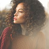 Atmospheric portrait of beautiful young lady. Outdoor atmospheric lifestyle photo of young beautiful lady. Brown hair and eyes. Warm fall. Autumn vibes. Softness stock images