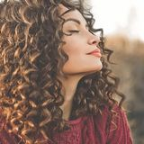 Atmospheric portrait of beautiful young lady. Outdoor atmospheric lifestyle photo of young beautiful lady. Brown hair and eyes. Warm fall. Autumn vibes. Softness stock photography